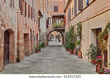 Buonconvento. Siena, Tuscany, Italy: picturesque narrow street in the historic center of the village - stock photo