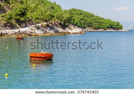 Buoy marking the navigable depth - stock photo