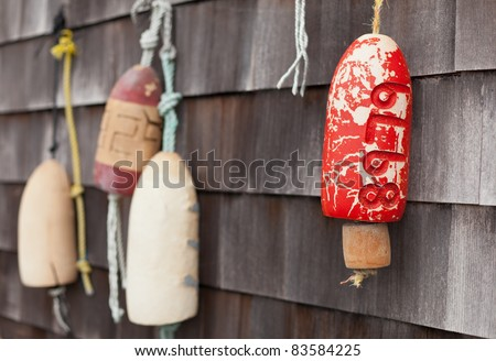 Buoys decorating a wall in Mystic, Connecticut, New England, United States of America, North America - stock photo