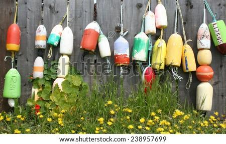 Buoys on a fence, Half Moon Bay CA - stock photo