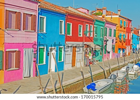 Burano houses by a narrow canal