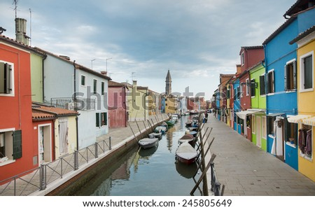 Burano island in Venice with colorful houses and boats, Italy - stock photo