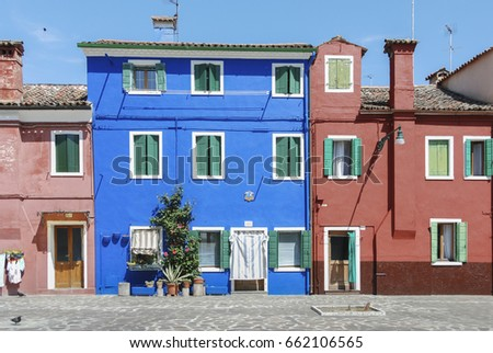 BURANO, ITALY - APRIL 18, 2009: Street with colorful buildings in Burano island, a gracious little town full of canals, near Venice - Italy
