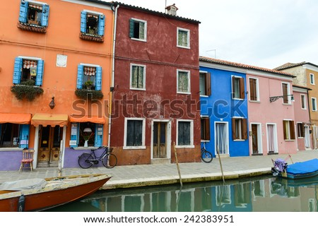 BURANO, ITALY - October 23: Canal with colorful houses on the famous island Burano, Venice on October 23, 2014 in Burano. Venice and the Venetian lagoon are on the UNESCO World Heritage List