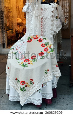 BURANO, VENICE - SEP 23, 2014: Very popular souvenir in Burano lace store. Burano Island is the oldest place for lace craftsmanship. The first Burano lace trace back to 1500