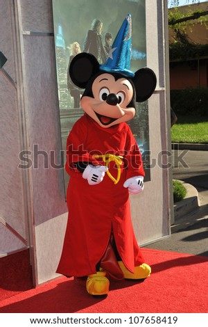 "BURBANK, CA - JULY 12, 2010: Mickey Mouse at a benefit screening for ""The Sorcerer's Apprentice"" at Walt Disney Studios. - stock photo"