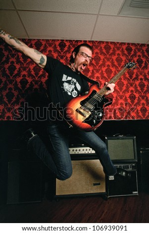 BURBANK, CA - MAY 01: Eagles of Death Metal singer/frontman, Jesse Hughes poses for us, while recording their new record at Pink Duck Studios in Burbank, CA on May 1, 2008. - stock photo