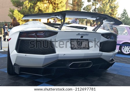 BURBANK/CALIFORNIA - JULY 26, 2014: Aft section of a 2014 Lamborghini owned by Giovanna Gianelle on display at the Burbank Car Classic July 26, 2014, Burbank, California USA  - stock photo
