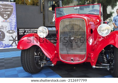 BURBANK/CALIFORNIA - JULY 26, 2014: 1932 Ford Roadster customized by West Coast Customs at the Burbank Car Classic July 26, 2014, Burbank, California USA  - stock photo