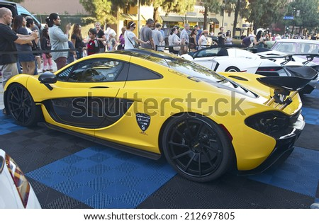 BURBANK/CALIFORNIA - JULY 26, 2014: 2015 McLaren owned by Giovanna Gianelle on display at the Burbank Car Classic July 26, 2014, Burbank, California USA  - stock photo