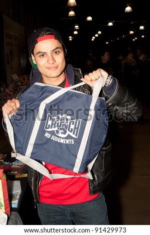 BURBANK - DEC 23: Kiowa Gordon receives a gift from Crunch Gym while  attending  Racers Edge Karting-Spark of Love Toy Drive, December 23, 2011 in Burbank, CA - stock photo