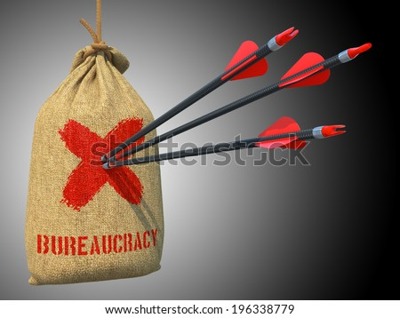 Bureaucracy - Three Arrows Hit in Red Mark Target on a Hanging Sack on Grey Background. - stock photo
