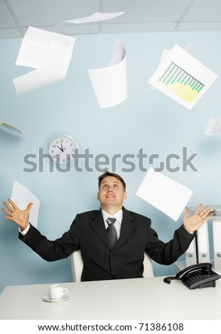 Bureaucrat -  businessman juggling documents - stock photo