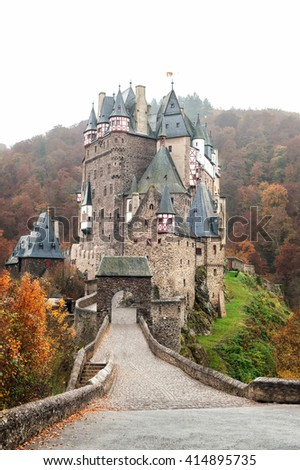 Burg Eltz picturesque medieval castle at the rhine valley Germany in fall season, Germany. Schloss B�¼rresheim Mayen. Outdoors vertical image - stock photo