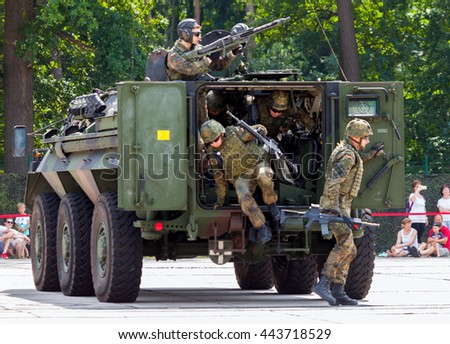 "BURG / GERMANY - JUNE 25, 2016: german military armoured personnel carrier, Fuchs ""Fox"" drives on open day in barrack burg / germany at june 25, 2016"