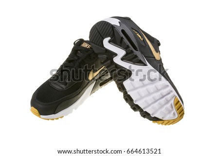 BURGAS, BULGARIA - DECEMBER 29, 2016: Nike Air MAX women's shoes - sneakers in black, isolated on white, with clipping path. Nike is a global sports clothes and running shoes retailer.