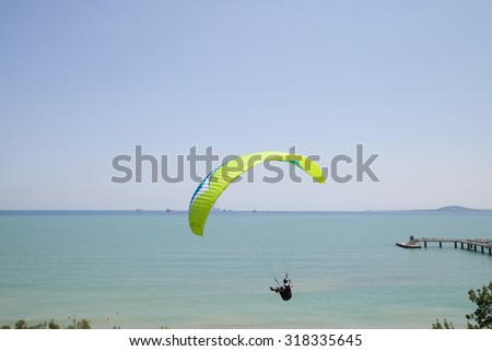 Burgas - July 24: Competition Accuracy landing paragliding - paraglider against the blue sky and sea, July 24 to 26, 2015 to July 24, 2015, Burgas, Bulgaria