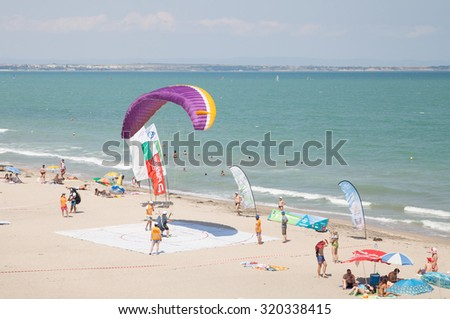 Burgas - July 24: Race suit landing paraglider - paraglider lands in the goal on the beach on July 24 to 26, 2015 July 24, 2015, Burgas, Bulgaria