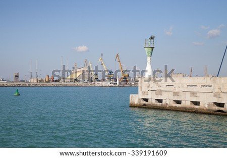 Burgas - October 25: View from the small harbor lighthouse amid sea, cranes, buildings and blue sky on October 25, 2015 Bourgas,