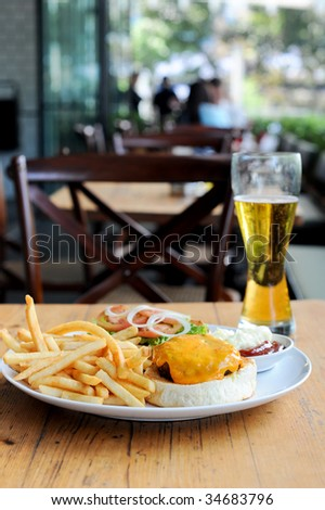 Burger and beer for lunch - stock photo