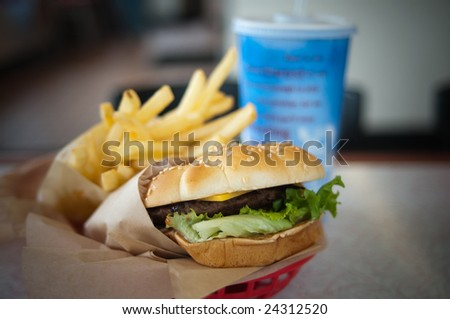 Burger basket with fries and a soda. - stock photo