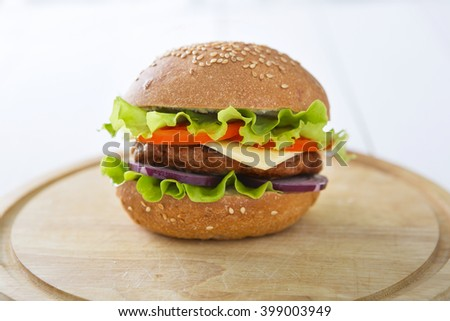 Burger hamburger cheeseburger on table wooden surface