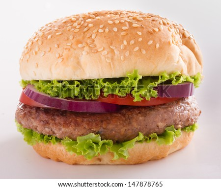 Burger isolated on light background. Fast food meal.
