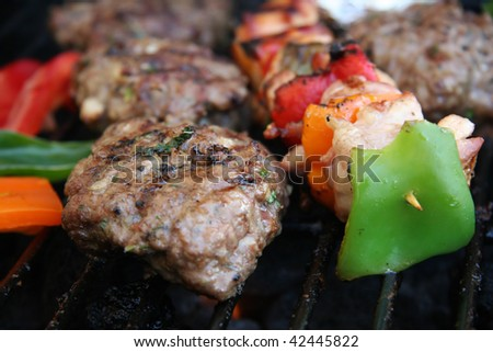 Burger on the grill - stock photo