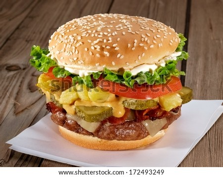 Burger on wooden table - stock photo