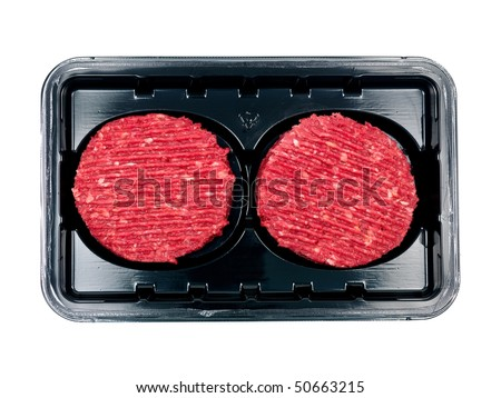 Burger patties in a supermarket packaging tray isolated on a white background - stock photo