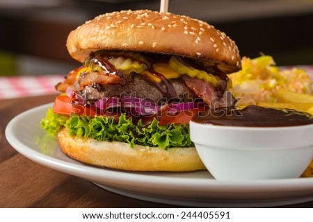 burger with bbq sauce and chips - stock photo