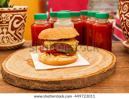 Burger With Beef, Tomato, Cheese, Lettuce and Onion. Street food - stock photo