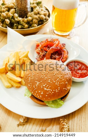 burger with beer - stock photo