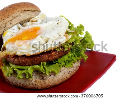 Burger with black pepper on white background