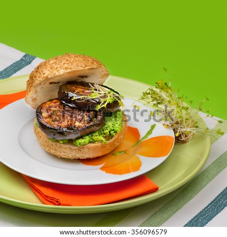 Burger with eggplant, tamarind and pea pesto with mint