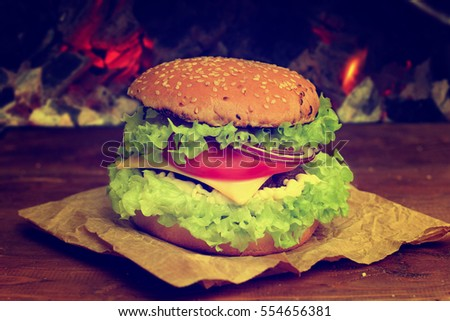 burger with grilled beef, cheese and vegetables