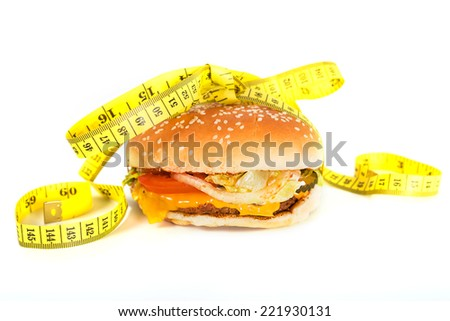 Burger with measure tape - stock photo