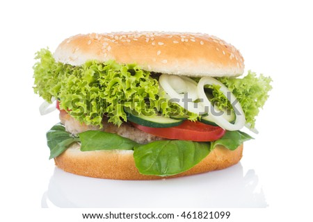 Burger with meat, greens, onions, tomatoes on a white background