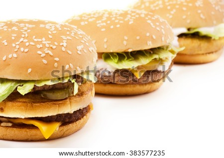 Burgers in a row isolated on a white background