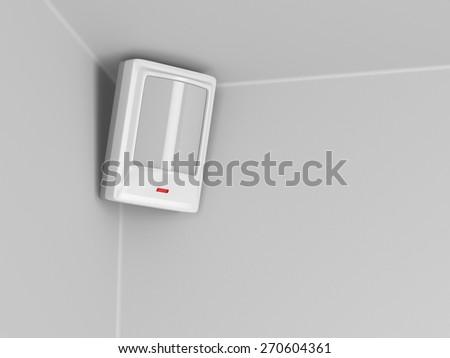 Burglar alarm motion sensor on grey wall - stock photo