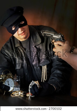 Burglar caught red-handed with his hands full of jewellery - stock photo
