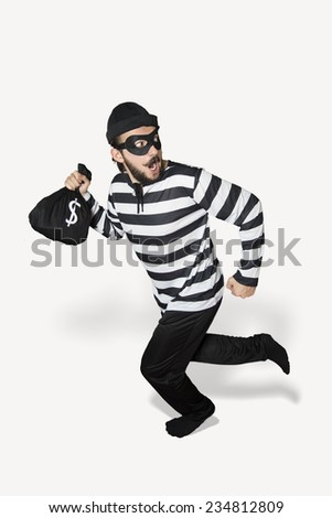 Burglar got caught whlie he is running. - stock photo
