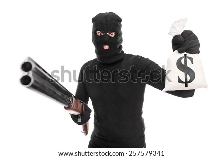 Burglar holding a bag of money and a shotgun isolated on white background - stock photo