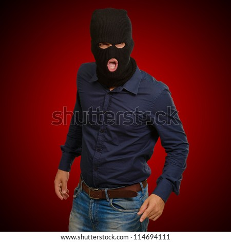 Burglar in face mask isolated on blue background
