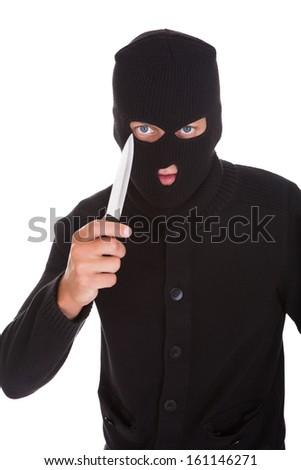 Burglar Man In Balaclava Holding Knife Isolated On White Background - stock photo