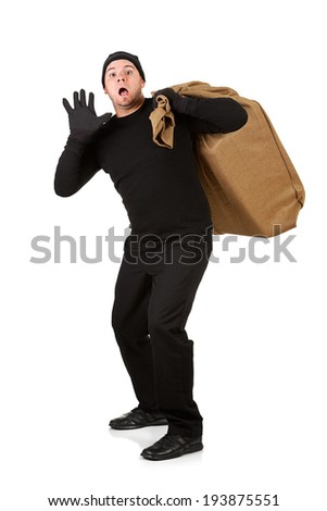 Burglar: Man With Stolen Items Surprised By Police - stock photo