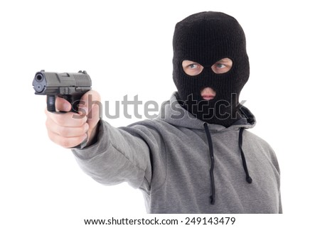 burglar or terrorist in mask aiming with gun isolated on white background