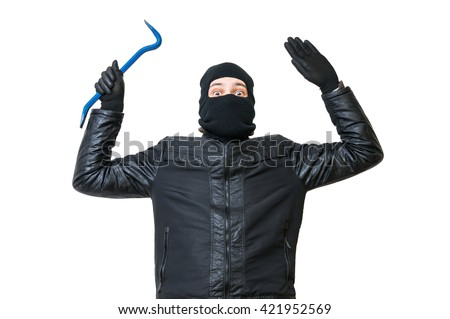Burglar or thief is putting hands up. Arrested robber is giving up. Isolated on white background. - stock photo
