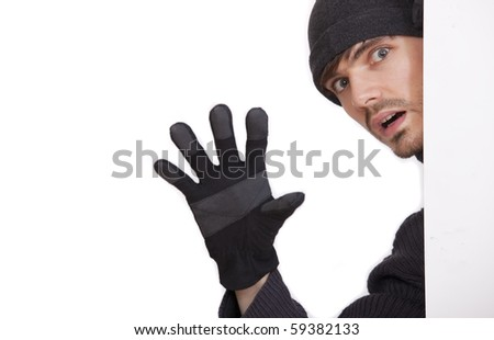 burglar stretching out the hand on a white background - stock photo