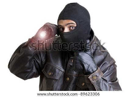 Burglar with flashlight isolated in white - stock photo